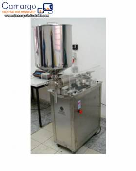 Filling machine for hot pasty products